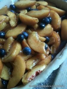 Fruit mixture in prepared pastry crust in baking dish.